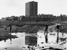 Boys Throwing Rocks into Puddles - Manchester 1966 Photographic Print