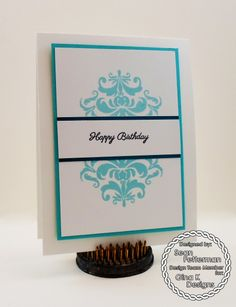 The Gina K Designs products used in this card are:  The Delicate Damask stamp set by Beth Silaika for Gina K Designs Pure Luxury card stock in 120 lb Base Weight White, 80 lb Layering Weight White and Ocean Mist - Pure Luxury Color Companions Ink in Black Onyx and Ocean MistHappy Birthday