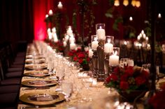 Deep red rose floral wedding centerpieces with white candles, photo by Melissa Jill Photography