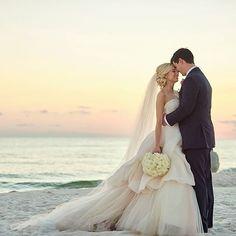 Enchanted with this @ja_bridal bride and the newlyweds beach wedding. #JustinAlexander #JABridal #JAbride #destinationwedding #romance #newlyweds #inlove #weddingphotography #futuremrs #mrandmrs #realwedding #weddingideas #weddingdress #bridalgown #luxury