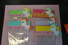 Unicorn favor bags--don't forget to add the Polaroid with the picture of the child's face painted!