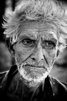 Wistful expression on the well worn face of a man from Patna India