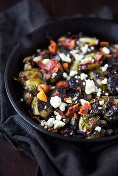 Oven roasted brussels sprouts with a blueberry balsamic glaze tossed with bacon and blue cheese makes for a delectable addition to your holiday table!