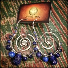 Lapis wrapped on sterling silver swirl hoops. by GypsyLotusCo