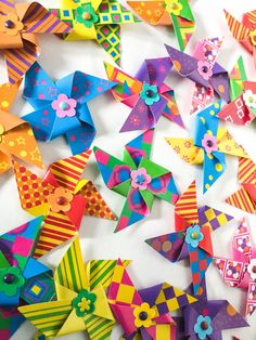A personal favorite from my Etsy shop https://www.etsy.com/listing/97283091/23-paper-pinwheels-colorful-pinwheels