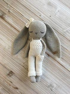 Crochet longear bunny with salopette trousers and bow Crochet Rabbit, Cute Crochet, Crochet Crafts, Crochet Projects, Crochet Animal Patterns, Stuffed Animal Patterns, Crochet Animals, Newborn Toys, Baby Toys