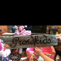 Cut vinyl word out on cricut and outline on an old piece of wood from an old barn of ours-after outline the word onto the wood remove the vinyl and paint the word, added rhinestones with hot glue gun and put brackets on back to hang on wall with pictures of grandkids!