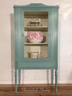 """This lovely vintage china cabinet/hutch is the perfect piece to brighten up a room for spring. She is hand painted in Annie Sloan's Provence and Old White, distressed and sealed with clear and dark wax. This beautiful piece of furniture could be used as a china cabinet, display case, linen cabinet, the possibilities are endless! Measurements: 32""""wide x 16""""deep x 64""""tall ***I cannot ship this item. However, if you are within a few hours of Warrenton, VA I can likely deliver for a fee. P..."""