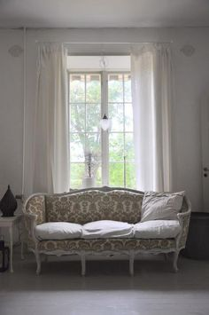 large windows, white curtains, comfortable, romantic seating