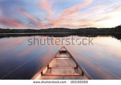 Canoe Bow on a Lake at Sunset - Ontario, Canada - stock photo