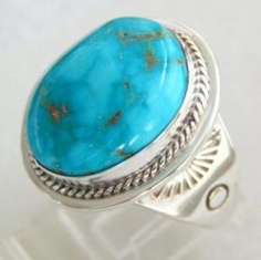 Natural cut and highly polished Fox Mountain Turquoise stone with nice light blue color and copper matrix encased in traditional hefty Navajo sterling setting, The Cab on the ring measures approximately 20mm or 7/8 of an inch top to bottom and 17mm or just under 3/4 of an inch wide. Size 12 ...$158