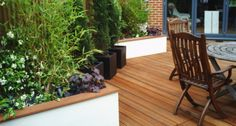 Beautiful retaining wall - wooden capping on rendered retaining wall
