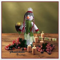 This is a free Christmas Pattern from Phoenixknits. I hope it will bring even more cheer to your Christmas dinner table. The little snowman will fit almost any bottle top, from wine and spirits to cordials and pop. It would also make a nice addition to a Christmas gift of wine etc.Materials neededDK or equivalent yarn in the following colours White less than 25g Medium Green less than 15g Light green - scrap Red less than 5g Grey less than 10g Orange -scrap Pair of beads approximately 6mm…