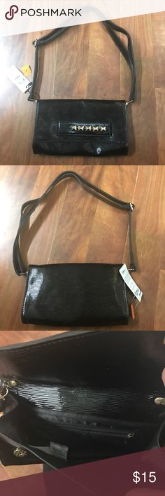 Black small purse with adjustable strap nwt Black small purse with adjustable strap nwt Bags
