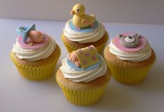 http://www.thecupcakeblog.com/wp-content/uploads/2011/03/Sugarpaste-Baby-Shower-Cupcakes.jpg
