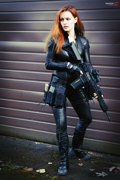 Wife Material redhead in tight black leather catsuit tactical rifle