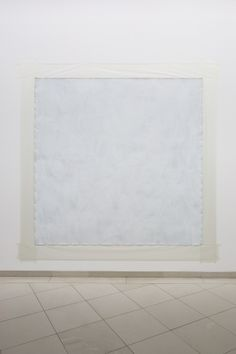 Robert Ryman: Adelphi, 1967.  Oil on unstretched linen canvas with staples, waxed paper and masking tape.