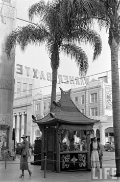 """This is the ticket booth of Grauman's Chinese Theatre forecourt during the May 1936 run of an MGM picture called """"Robin Hood of El Dorado"""" starring Warner Baxter. This booth was added to Grauman's in 1934 and was referred to as a """"grind"""" box-office. That marked the change from presenting a """"movie + stage show"""" format to a """"short + newsreel + feature."""" This format (known as """"grind"""") ran continuously all day and you could stay as long as you wanted!"""