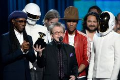Nile Rodgers, Daft Punk, Paul Williams, and Pharrell Williams accept Album Of The Year honors on the 56th Annual GRAMMY Awards on Jan. 26 in Los Angeles