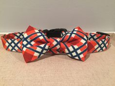 A personal favorite from my Etsy shop https://www.etsy.com/listing/235970407/orange-navy-cream-plaid-dog-collar-with