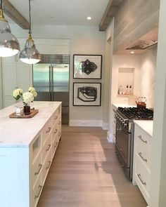 """Cabinet paint color is Benjamin Moore OC-17 White Dove. Floors are 6"""" white oak…"""