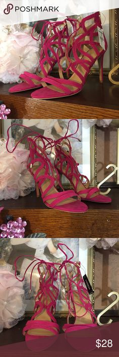 EXPRESS HOT PINK STRAPPY HEELS BRAND: EXPRESS  TYPE: STRAPPY, STILETTO HEELS WITH BACK ZIPPER AND SUEDE FEEL.  COLOR: PINK  SIZE: 10M  APPROXIMATE MEASUREMENTS: 4-4.5IN HEEL DEPENDING ON POINT OF MEASUREMENTS.  FABRIC CONTENT: MAN MADE MATERIALS  CONDITION: NEW WITH TAGS; MARKS ON BOTTOM OF THE SOLE. Express Shoes Heels