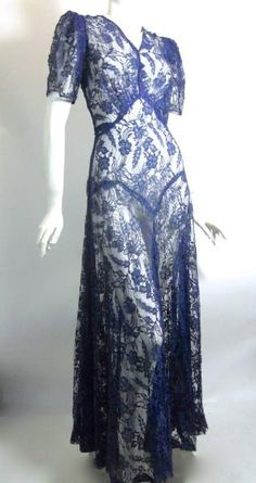 1930s cobalt blue lace and netting gown. V neck front and back, puff sleeves supported with blue horsehair braid at seams. Has coordinating velvet jacket. jαɢlαdy