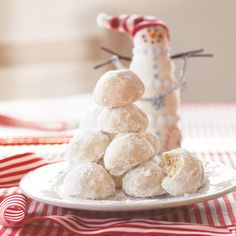 Lemon Coconut Snowballs ~ These are essentially a variation on traditional Danish wedding cookies aka Russian teacakes. ~ *Originally I found this recipe in a Christmas cookbook for Southern Living, but don't be dissuaded by the snowman – the coconut & lemon twist makes them perfect for Easter treats! | by Oxmoor House / Southern Living via MyRecipes.com