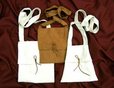 Peasant       Peasant clothing from the turn of 14th and 15th century consisting of linen braies, woolen tied hoses based on Herjolfsnes patterns, inner linen smock, outer woolen tunic, woolen hood and white linen coif is shown on previous pages. Here are presented linen carry bags.