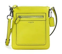 """COACH Legacy Leather Swingpack in Lemon Yellow Cheap handbags http://www.ashpants.com/cheap-coach-handbags  Made of leather. Approx. 7 1/2"""" x 8 1/2"""". Includes adjustable strap for shoulder or crossbody wear. Zip-top closure. Exterior front zip pocket. Interior cell phone and multifunction pockets. Fabric lining. Silver tone hardware."""