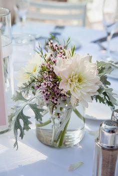 simple white & green wedding centerpiece / Koru Wedding Style: {Pink & White Florida Beach Wedding} Laura & Stephen