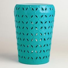 Refresh your outdoor seating arrangement with our drum stool, embellished with a punched pattern around the sides for a global-inspired look. In deep turquoise, it also makes a bold accent table.