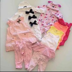 Baby Girl 6 Month Bundle Baby girl 6 month bundle. Includes 4 Carters sleeveless onesies, 1 Carters Dress with bloomers, 2 pairs footed pajamas with matching hats brands are Vitamins Baby and Miniclasix, and 2 pairs of Carters pants. All in gently used condition. No trades! Bundle to save. Thanks! Other