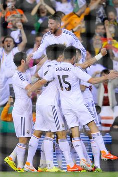 Real Madrid players celebrate after Angel Di Maria of Real Madrid CF scored the opening goal under a challenge by Jordi Alba of FC Barcelona during the Copa del Rey Final between Real Madrid and FC Barcelona at Estadio Mestalla on April 16, 2014 in Valencia, Spain.