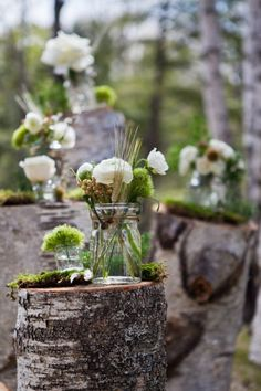 rutsic mason jars and moss wedding aisle / http://www.deerpearlflowers.com/45-dreamy-outdoor-woodland-wedding-ideas/
