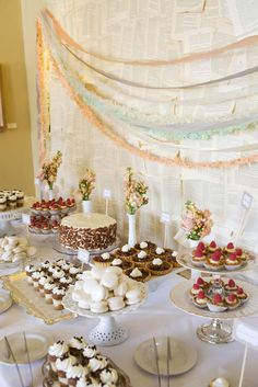 milk glass vases, vintage vintage cake/dessert pedestals and it even looks like they made some of their own cake/dessert stands from vintage plates and candle holders. Love!