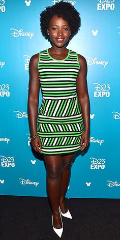 Last Night's Look: Love It or Leave It? Vote Now! | LUPITA NYONG'O | highlighting her new do in a green striped mini, white heels and bangles (all Lanvin) at the D23 Expo in Anaheim, California.
