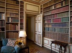 Reading room at Leeds Castle  - So, obviously, my dream home is not a castle; but the bookshelves look fairly imitable; and I love these two-tone painted panels - it's a feature I fell in love with in Estonia...