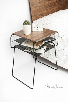 So stylish in its simplicity, inspired by the Bauhaus movement. The nightstand consists of two parts, the body made of iron tube 8 mm / 0.3 and lacquered in a powder high gloss black paint. The top board is made of solid wood and screwed to the body. Handmade in Spain. MATERIALS Iron