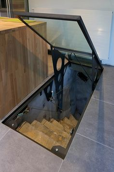 This, instead of the steel … Yves Deneyer – Metal joinery – Ironwork. This, instead of the steel grate over the basement egress window - Basement Doors, Home Wine Cellars, Wine Cellar Design, Egress Window, Casas Containers, Safe Room, Hidden Rooms, Secret Rooms, House Stairs