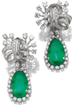 Pair of emerald and diamond ear clips. Each suspending a pear-shaped emerald drop within a border of graduated brilliant-cut diamonds, from a surmount of stylised bow design set with brilliant- and single-cut diamonds, clip fittings. Sotheby's.