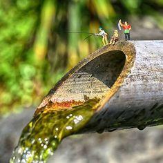 Fishing at waterfall