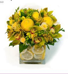 Fanciful bouquet of cymbidium orchids, roses, freesias and fancy tropical greens with
