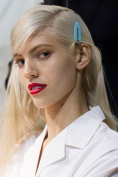 """Backstage before the Dior show, hair maestro Guido Palau noted that Raf Simons' forward-thinking Spring 2014 couture show required him to keep things pared down. """"He wanted something modern and nonreferential. It's not what you would imagine from couture hair, in that it is not elaborate."""" With that in mind, Palau devised """"simple hair with a messy side part,"""" which he created using Redken Shine Flash 02 Glistening Mist to amp up luster and, in turn, reduce volume. """"It's very real,"""""""