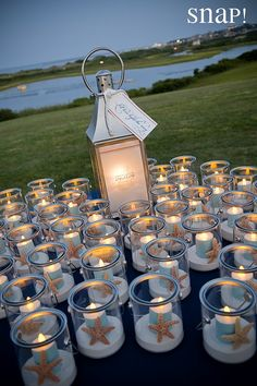 Lakeside beach wedding centerpiece with candles and starfish, spring wedding rec. [ Lakeside beach wedding centerpiece with candles and starfish, spring wedding reception ideas, wedding ceremony on a bu. Beach Wedding Centerpieces, Beach Wedding Favors, Diy Wedding, Dream Wedding, Wedding Day, Party Wedding, Trendy Wedding, Spring Wedding, Wedding Ceremony