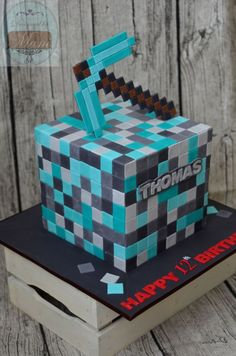 minecraft cube, 4 layers of chocolate cake filled with dark choc ganache. everything on this cake's edible including the pickaxe. Minecraft Birthday Cake, Minecraft Cake, Choc Ganache, Chocolate Cake, Diamond Cake, Minecraft Blocks, Minecraft Houses, 11th Birthday, Birthday Ideas
