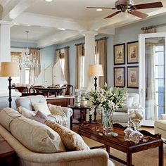 The khaki & blue color scheme works well here and enhances the white trim. Dark wood furniture gives the room a grounded, not too informal feel.It's really simple in a way, but very nicely done.
