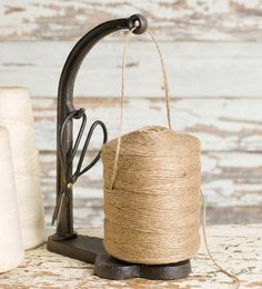 We literally depend on one of these every single day to fulfill your orders!  Our iron string holder includes shears and a huge roll of jute twine!   The shears
