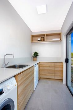 Again, I like the wood/white combination and also the flooring. The sink/tap look cheap though.