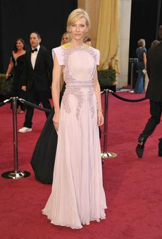 Cate Blanchett in Givenchy Couture, 2011: For her tendency to push the boundaries of safe red carpet fashion, Blanchett is a favorite around the Fashionista office. With this Givenchy dress, she managed to give the people what they wanted — an indisputable fantasy (see: that pretty pleated skirt) — while leaning into a thoughtful structure at the chest and shoulders. The dress's purple-leaning pink hue and yellow accents are once again a lovely, surprising color story. —Eliza.